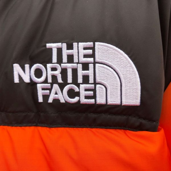 Logo doudoune The North Face Retro Nuptse 1996 - Orange