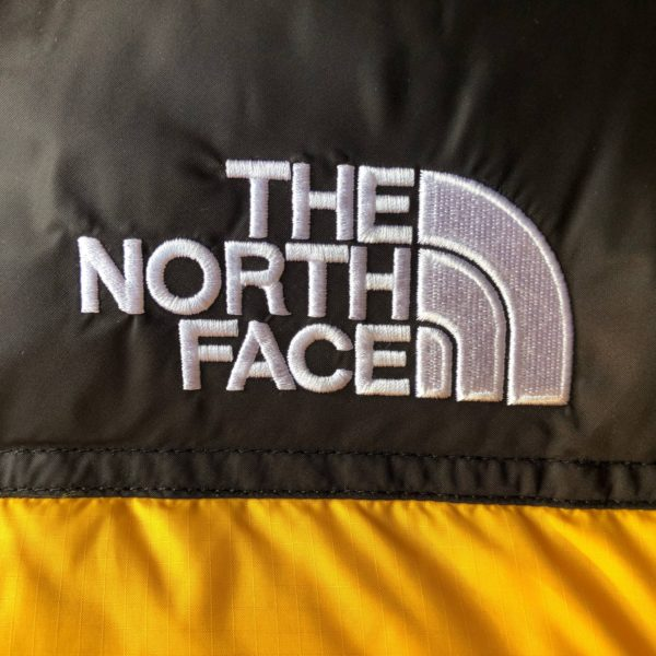 Logo doudoune jaune The North Face